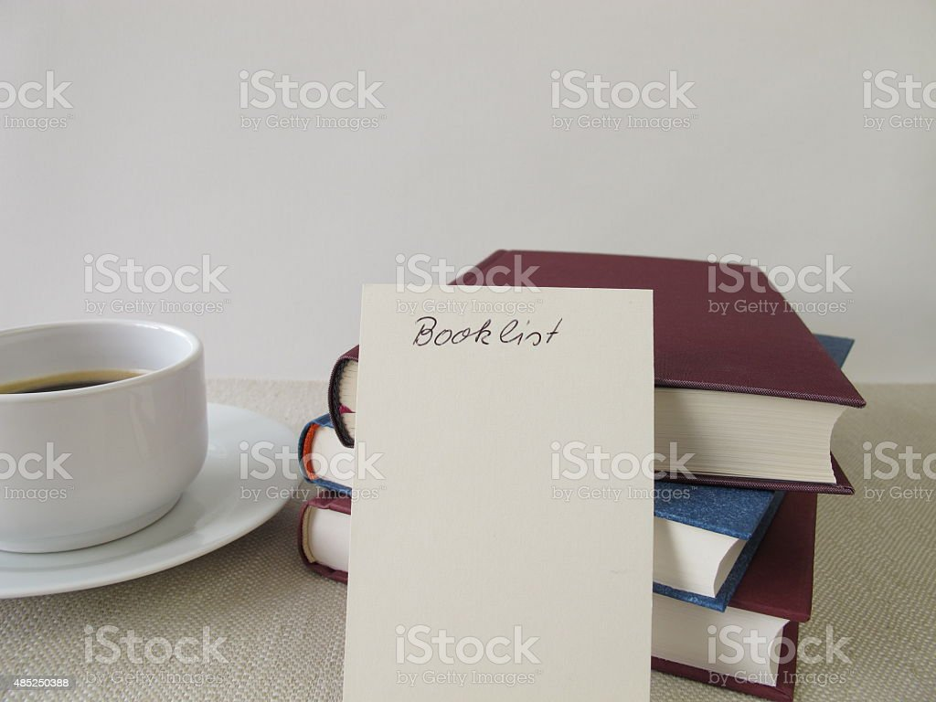 Books, blank booklist and cup of coffee stock photo