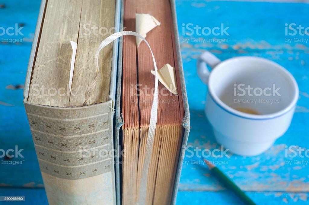 books ,close up, and cup of coffee and a pencil stock photo