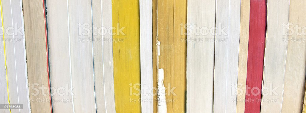 Books facing pages-out on a bookshelf stock photo