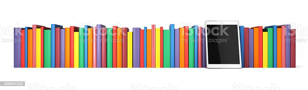Books in a row with the tablet in the foreground stock photo