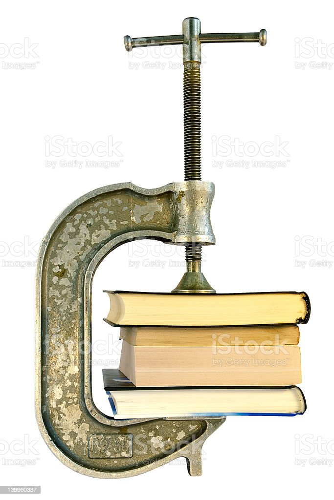 Books in a vice-archiving information royalty-free stock photo