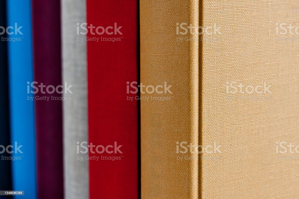 books in different colours stock photo