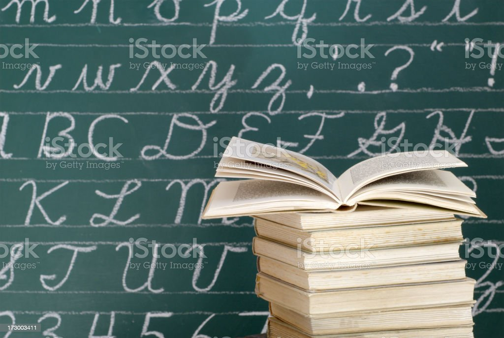 Books in front of a Blackboard stock photo