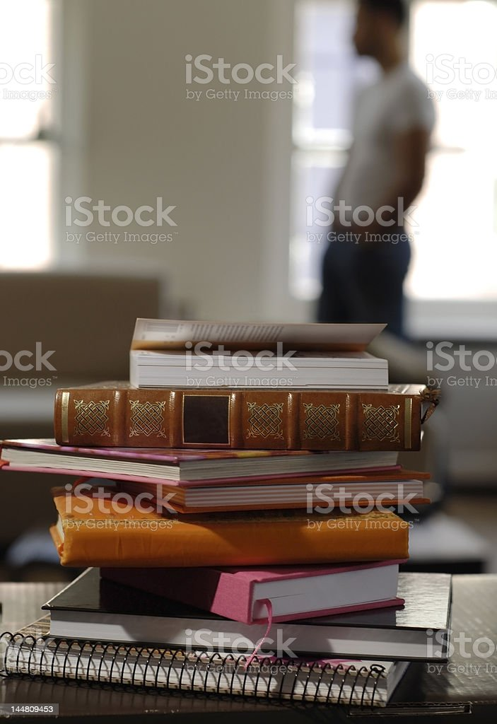 Books lying on a table royalty-free stock photo