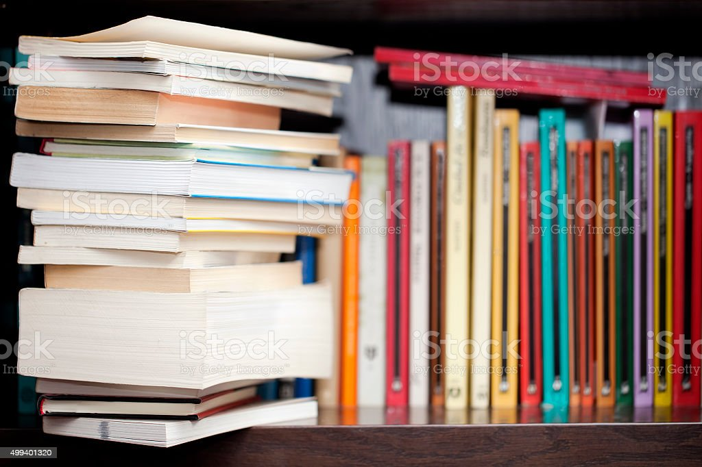 Books on a shelf, stack and colorful book spines. stock photo