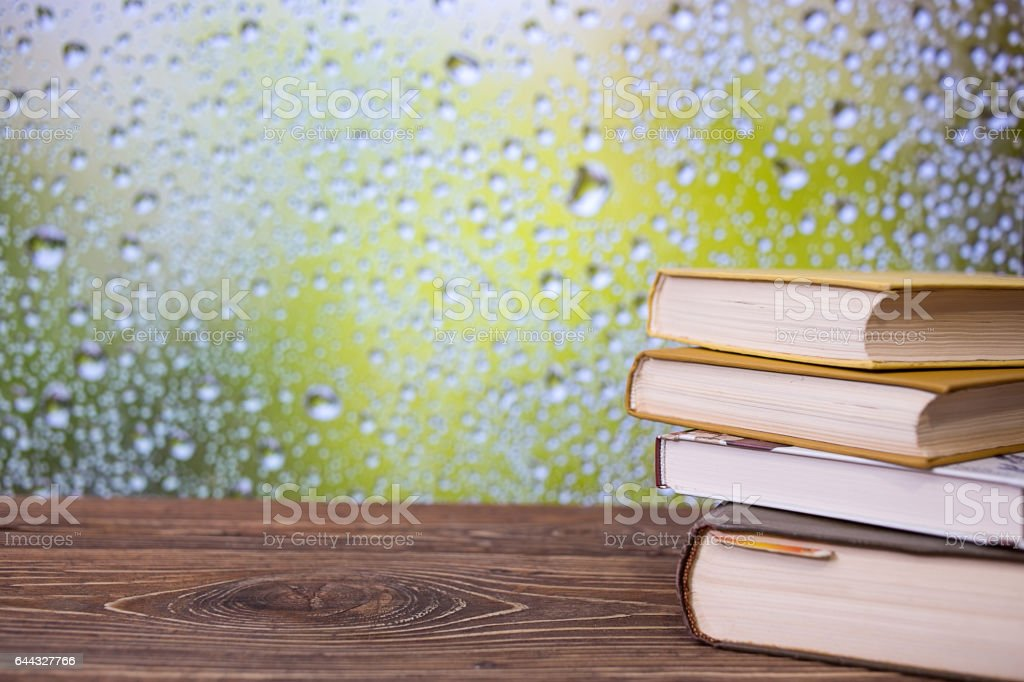 Books on an retro wooden table stock photo