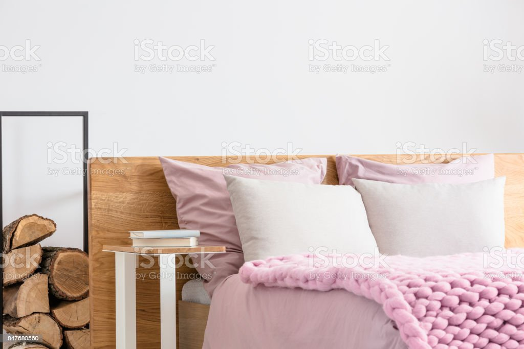 Books on bedside table stock photo