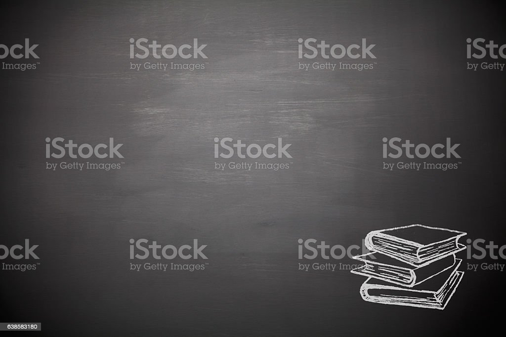 Books on blank blackboard stock photo