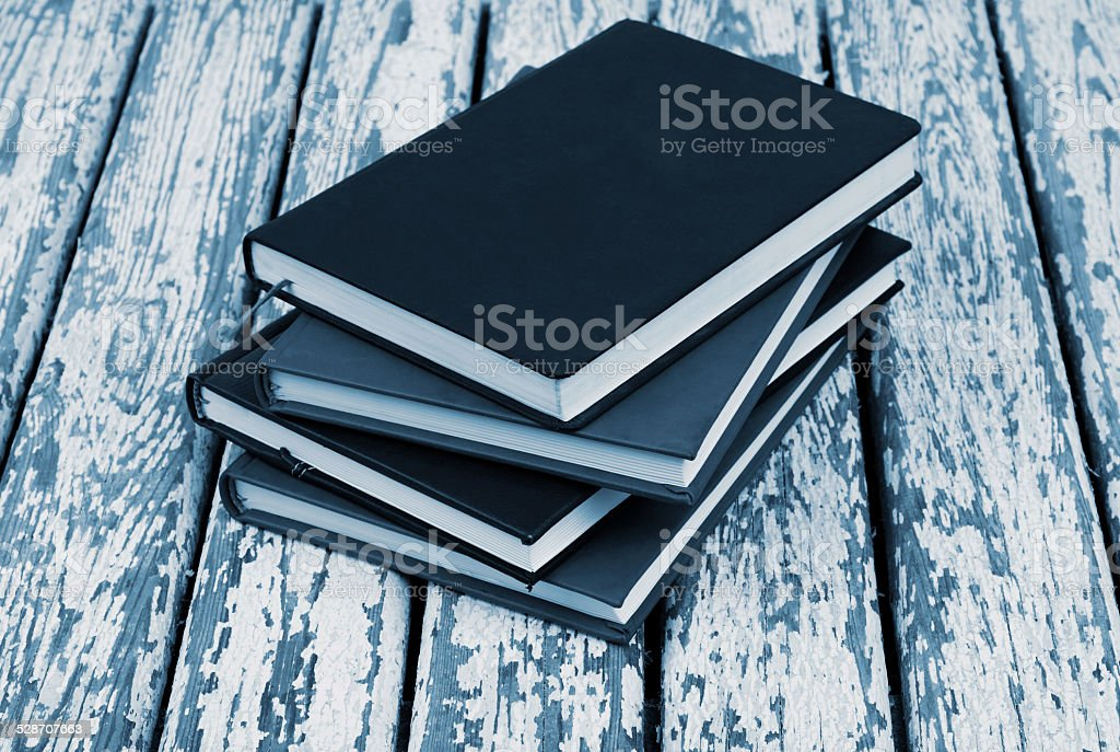 Books on old  table stock photo