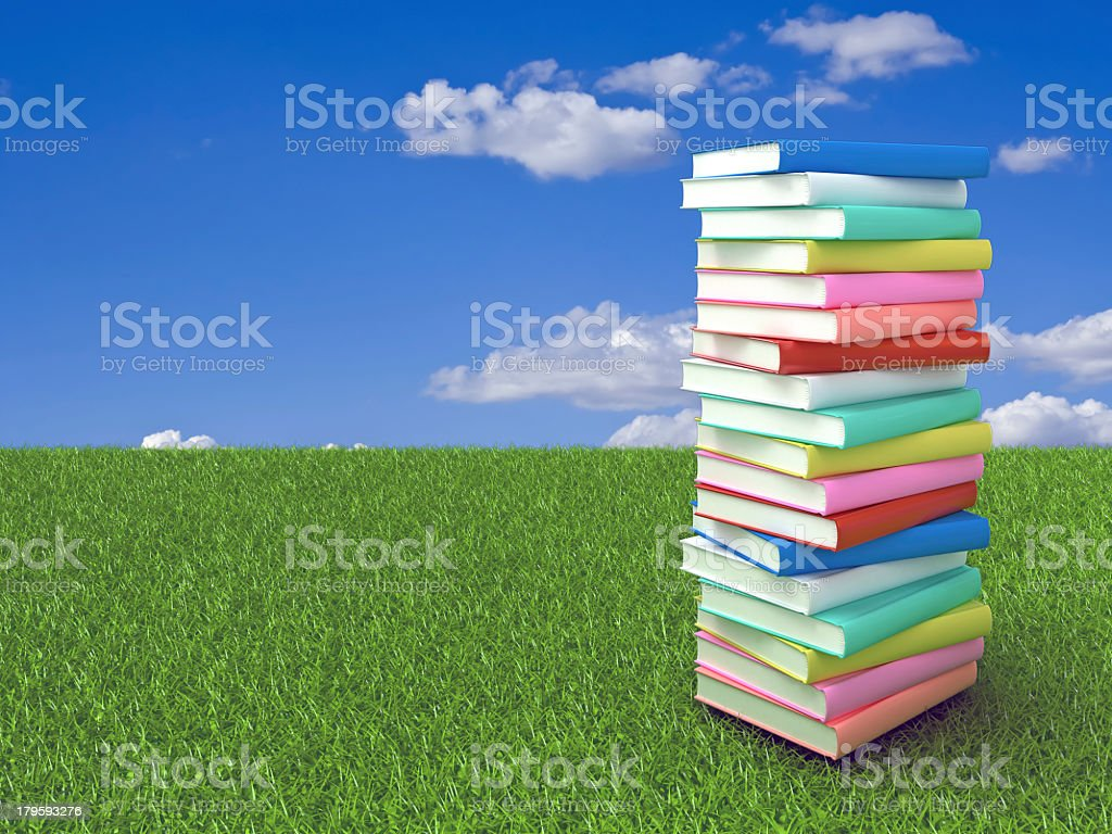 Books on the grass royalty-free stock photo