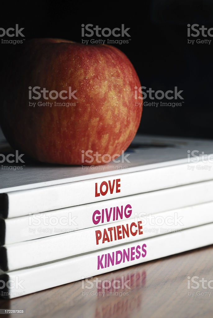 Books on Values and Character Building with an apple royalty-free stock photo