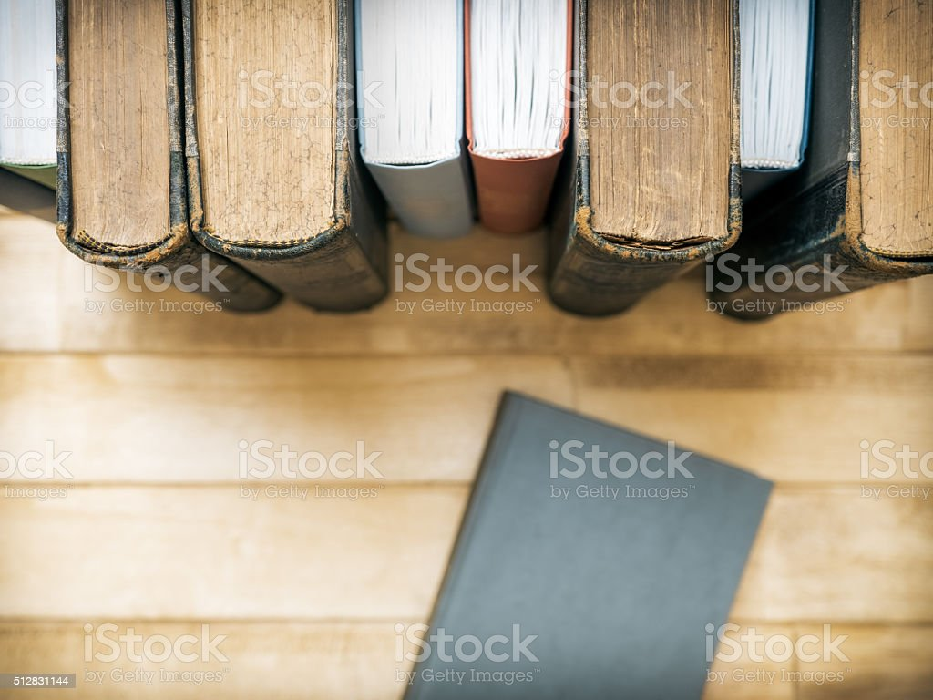 Books standing on the table stock photo