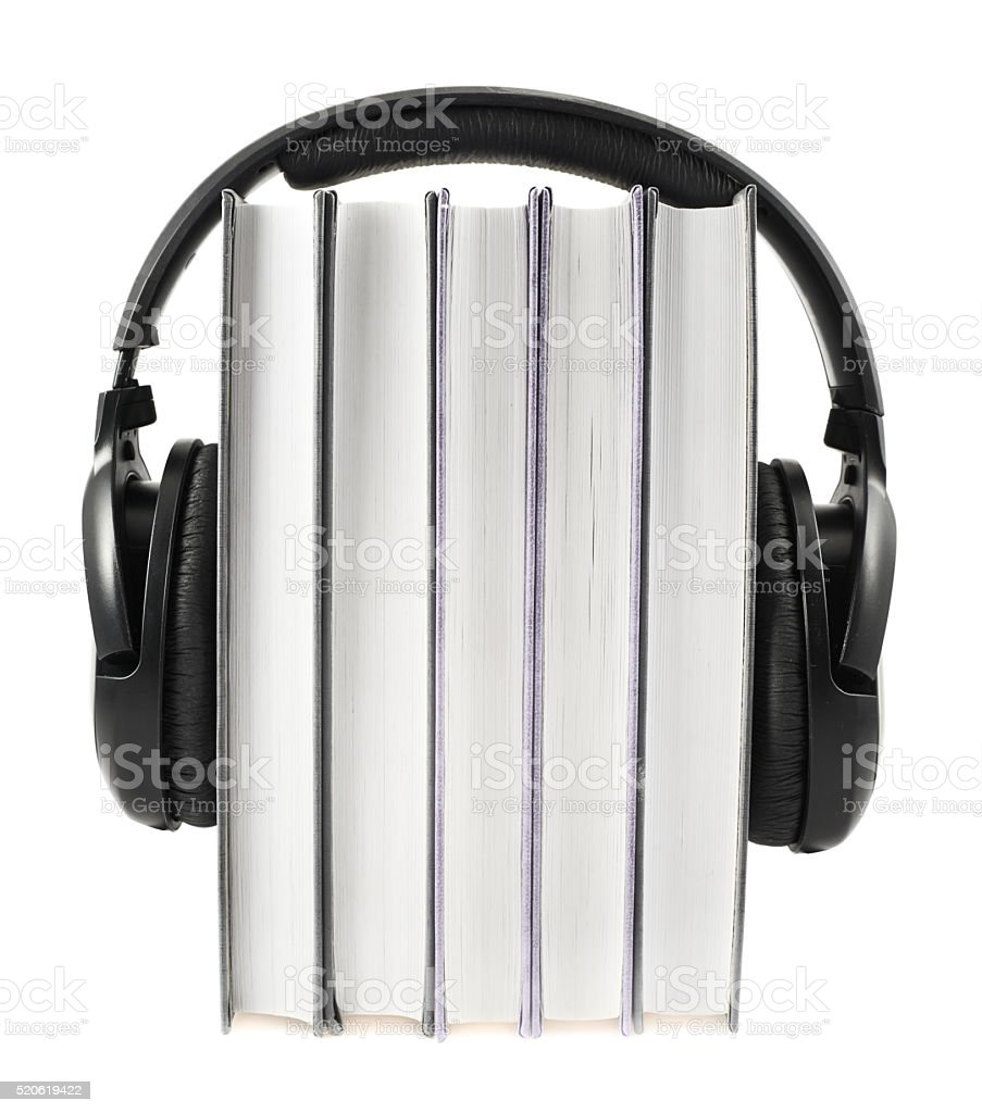 Books with a headphones on isolated stock photo