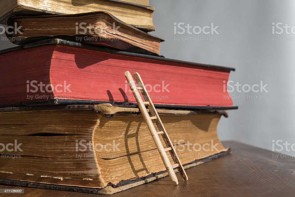 Books with a small ladde stock photo