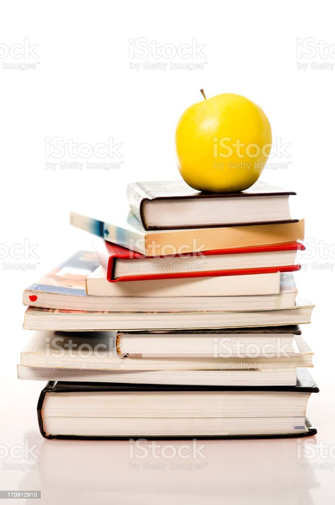 Books with a yellow apple royalty-free stock photo