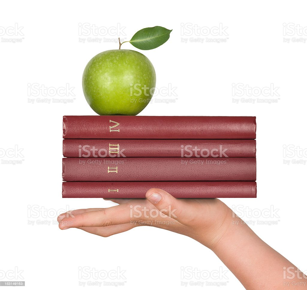 Books with apple in hand as a gift of education royalty-free stock photo
