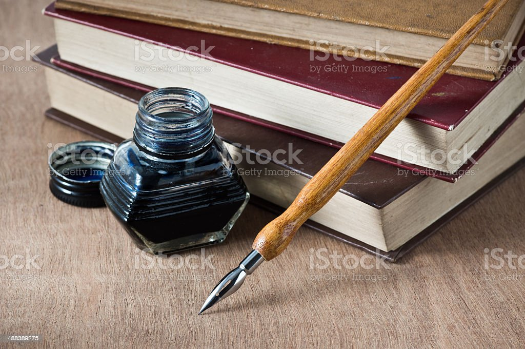 books with dip pen stock photo