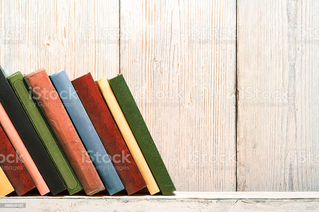 Books Wood Shelf, Old Spines Covers  White Vintage Wooden Wall stock photo