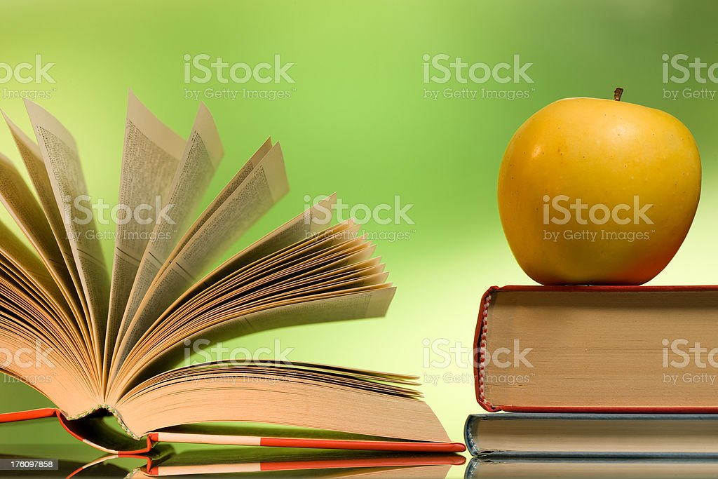Books, yellow apple royalty-free stock photo