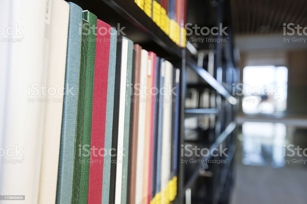 bookshelf in the library royalty-free stock photo