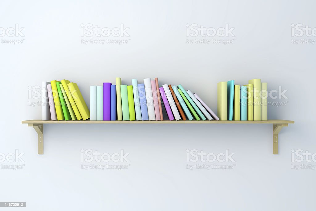 Bookshelf on the wall with multiple colorful books royalty-free stock photo