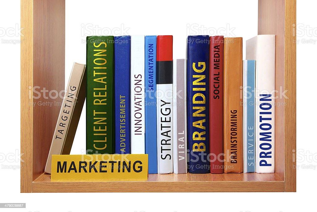 Bookshelf with marketing knowledge and skills royalty-free stock photo