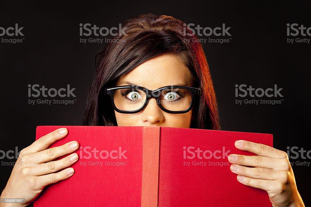 Bookworm Girl Reading Something Very Shocking royalty-free stock photo