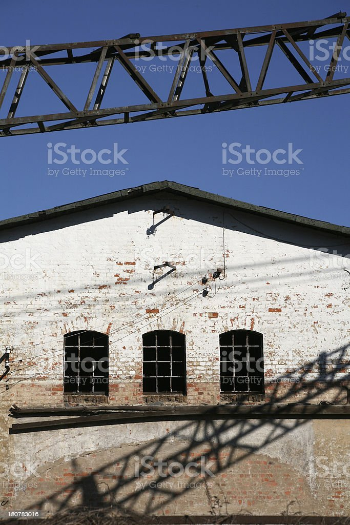 Boom before a ramshackle facade stock photo