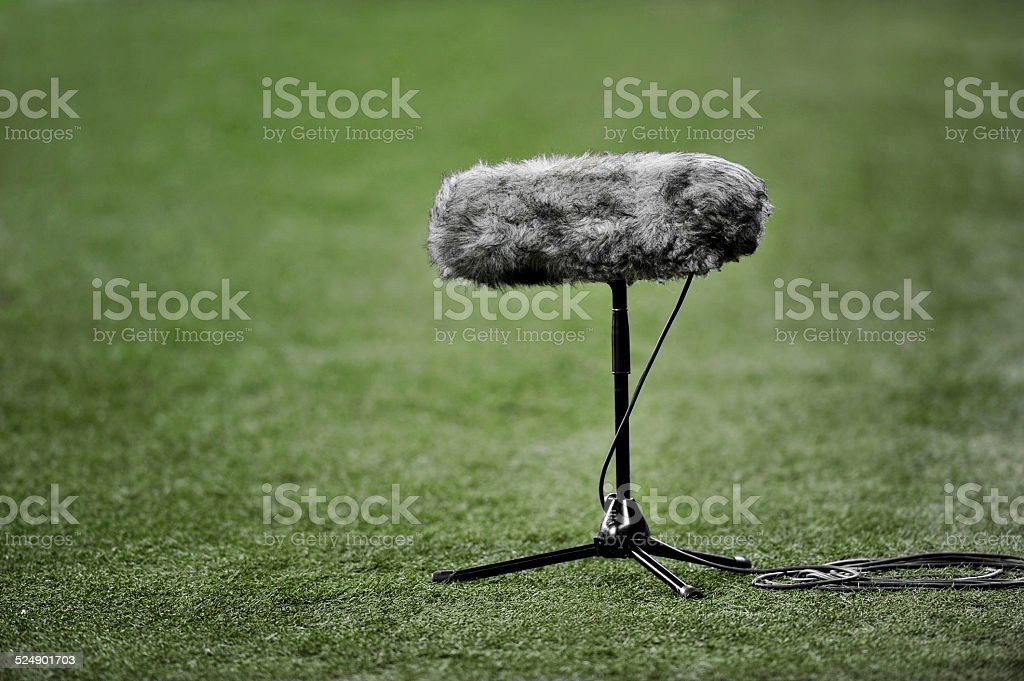 Boom microphone on soccer field stock photo