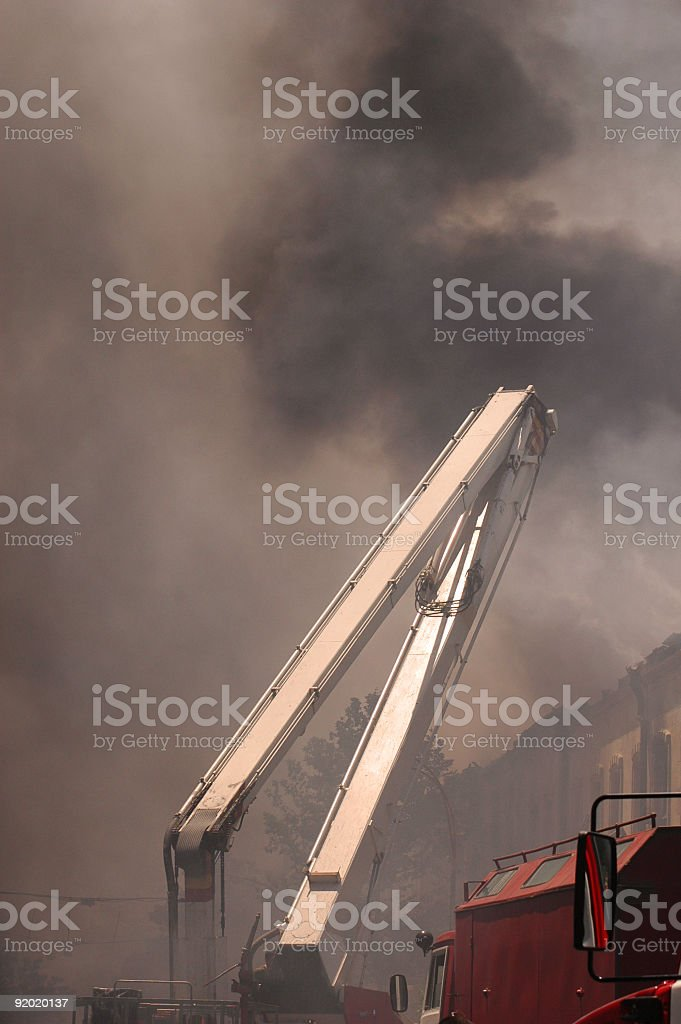 Boom of firetruck in the smoke during fire royalty-free stock photo