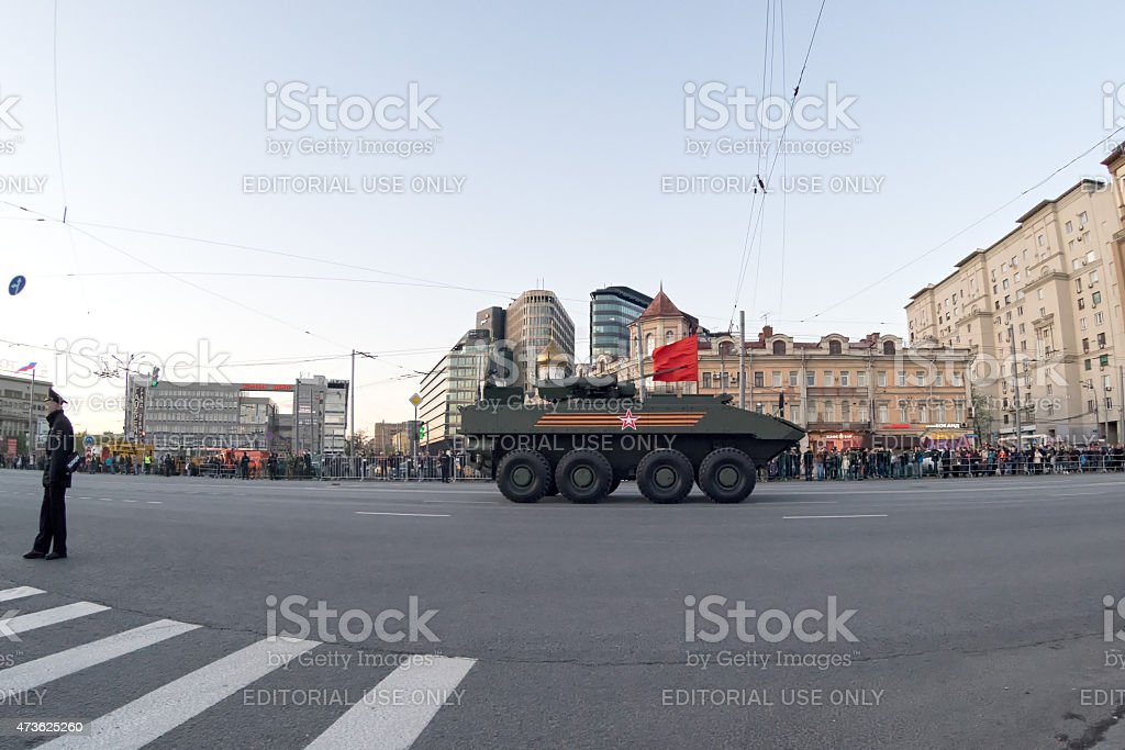 Boomerang amphibious armored personnel carrier (APC) and people on roadside stock photo