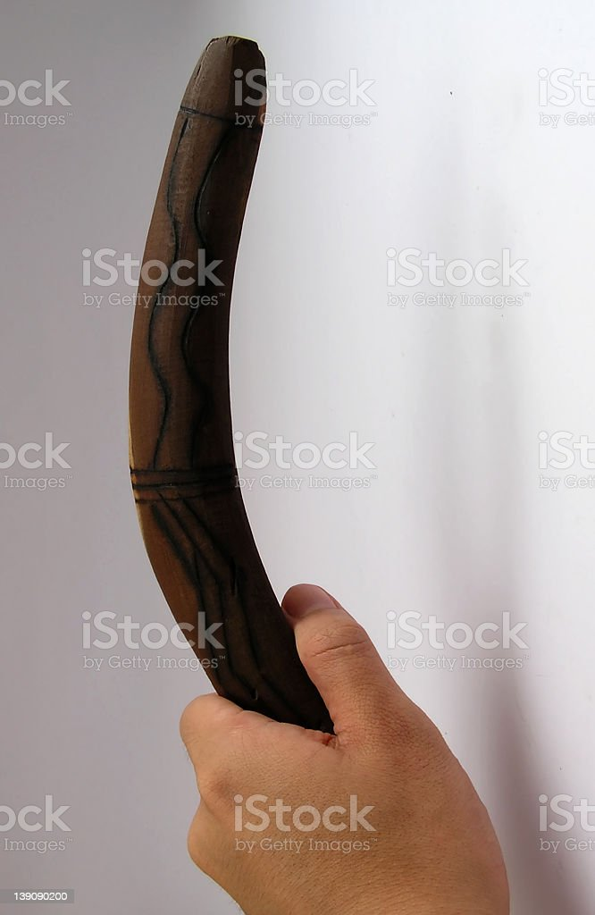Boomerang in hand royalty-free stock photo
