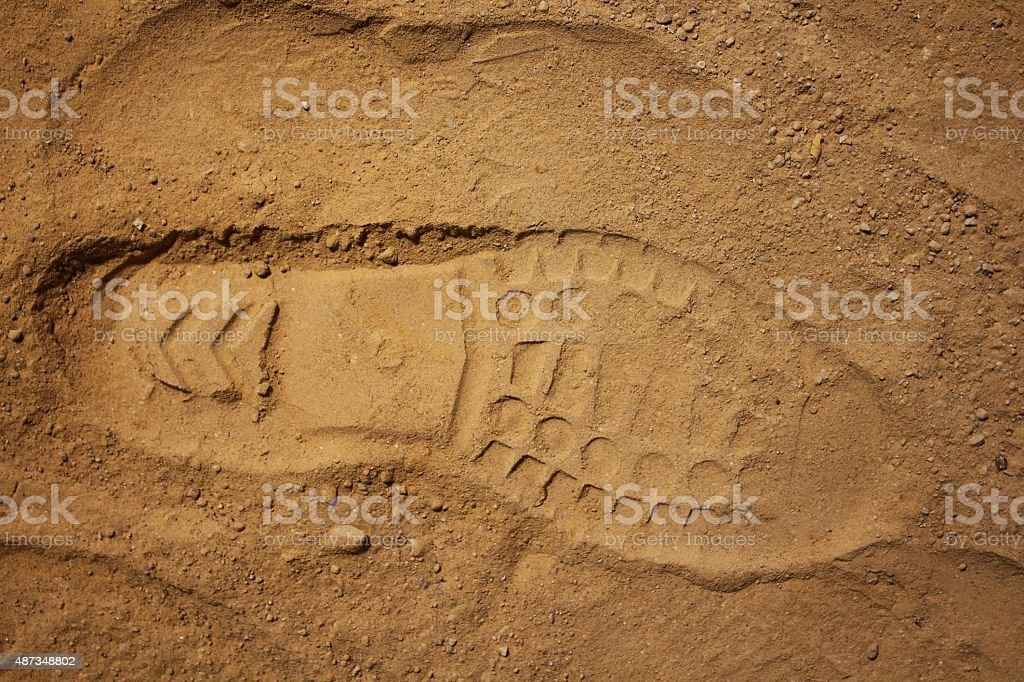 Boot footprint on the sand stock photo