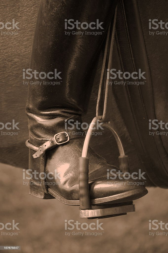 Boot In Stirrup. stock photo