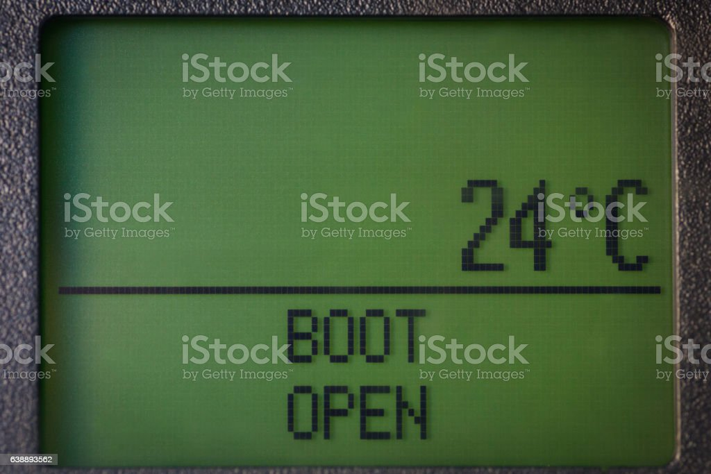 Boot open message and temperature on dashboard stock photo