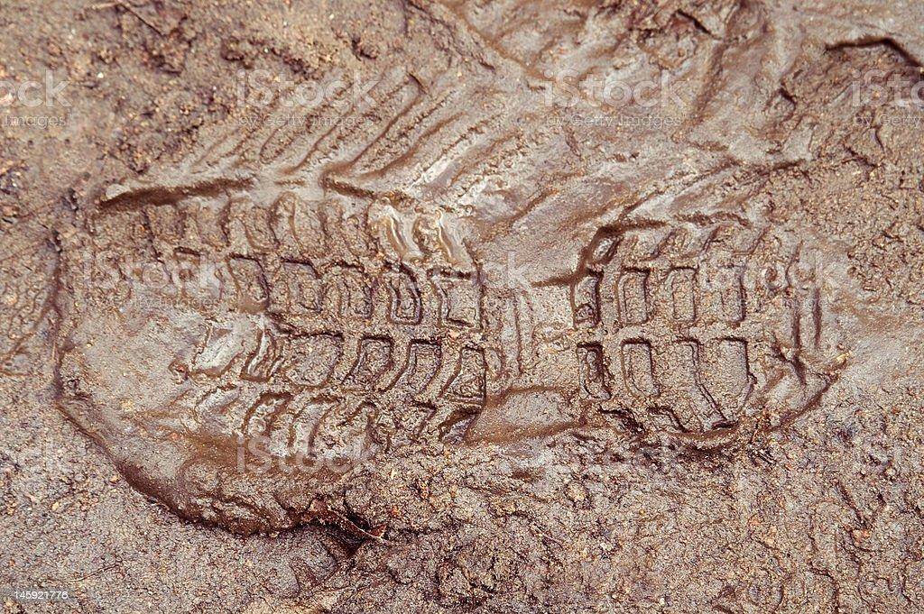 Boot print in brown mud stock photo