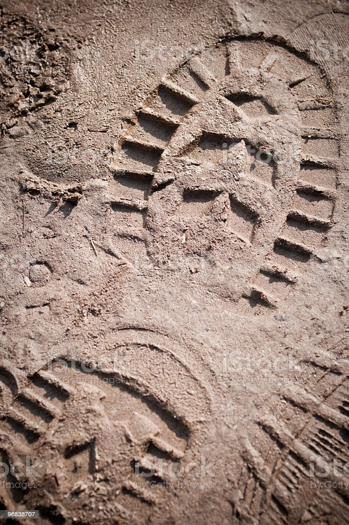 A boot print in the mud close-up stock photo