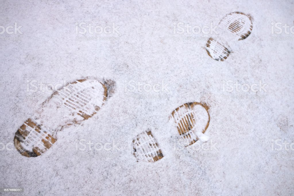 Boot traces in the snow stock photo