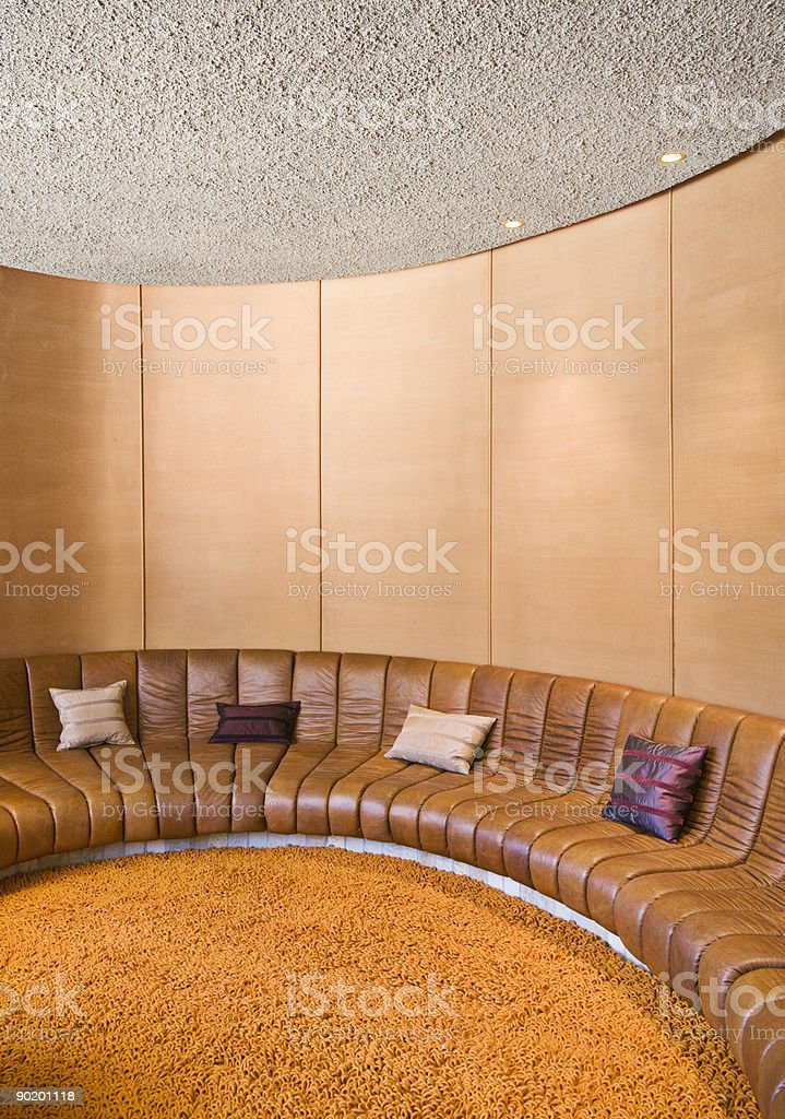 Booth-type seating in retro living room royalty-free stock photo