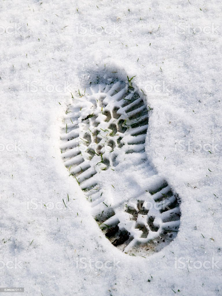Bootprint in the snow stock photo