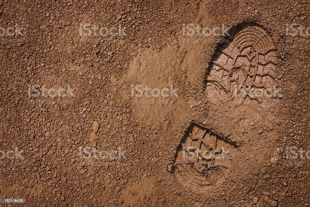 Bootprint on mud stock photo