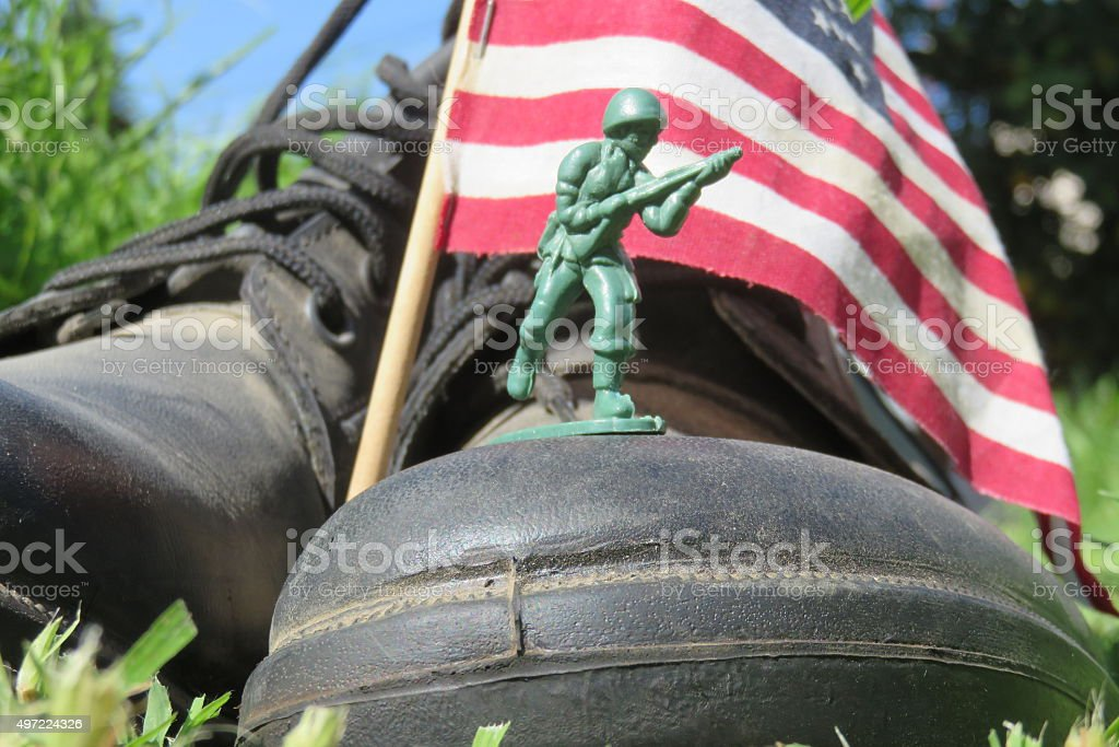 boots and american flag stock photo