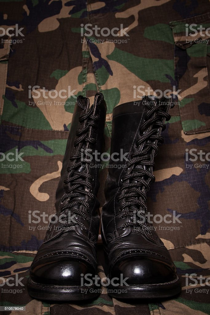 Boots and Camouflage stock photo