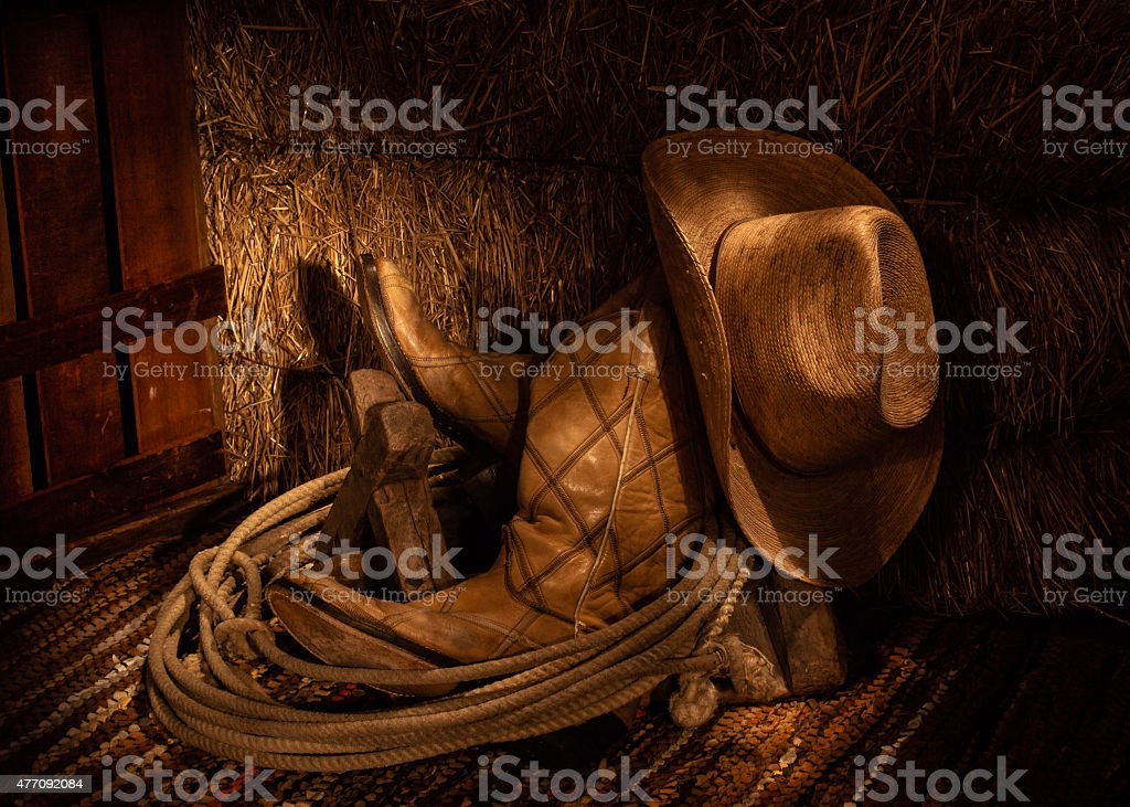 Boots and Hay stock photo