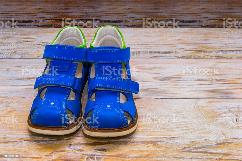 Boots, children's orthopedic. On wooden background stock photo