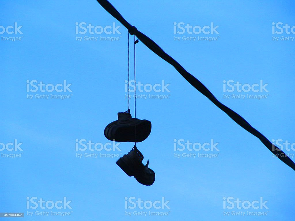 Boots hanging stock photo