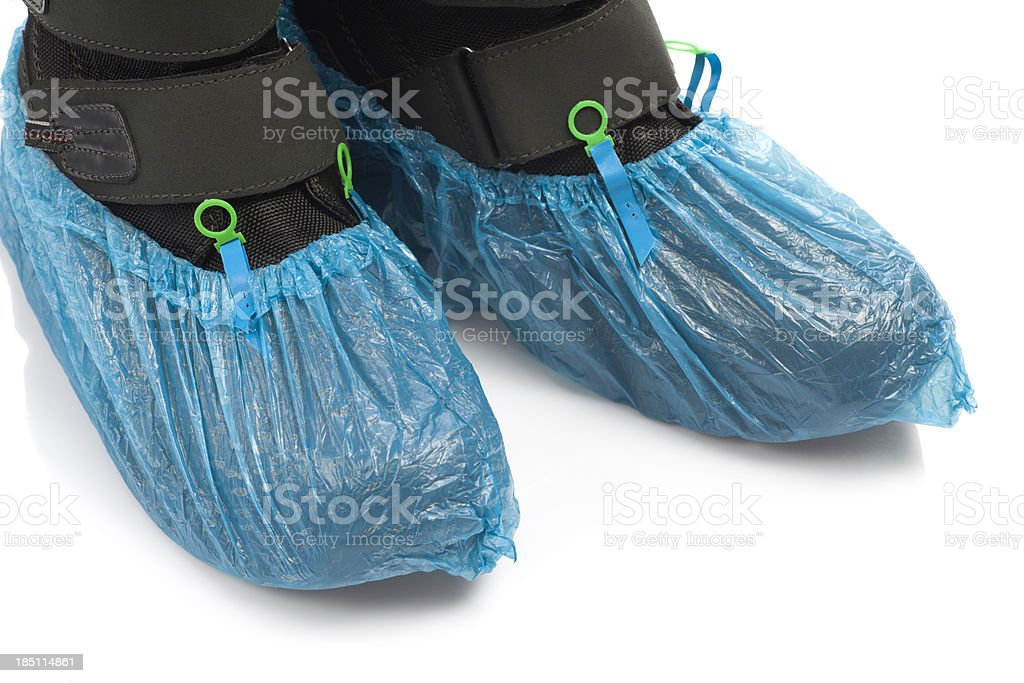 Boots in shoecovers stock photo