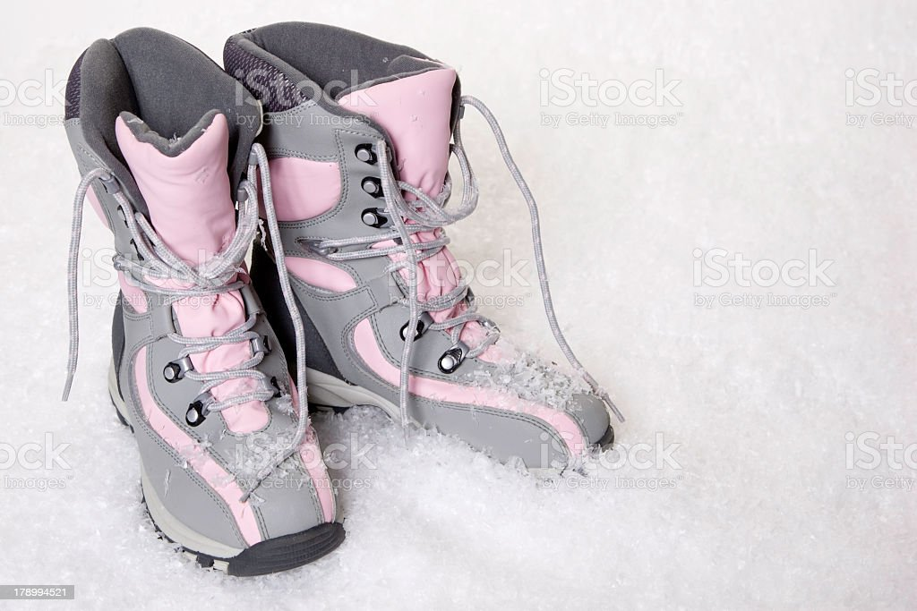 Boots in the Snow royalty-free stock photo