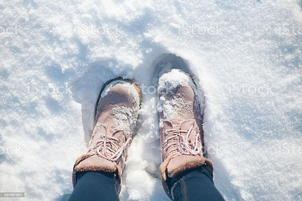 Boots in the snow stock photo