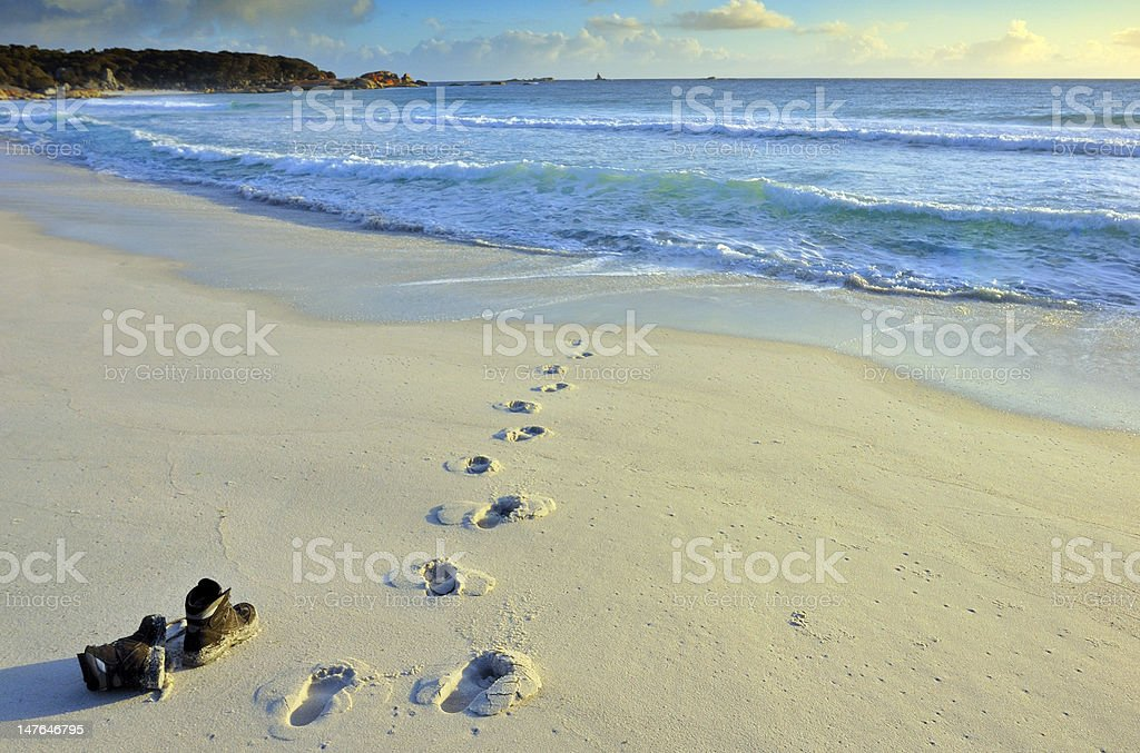 Boots left on the beach stock photo
